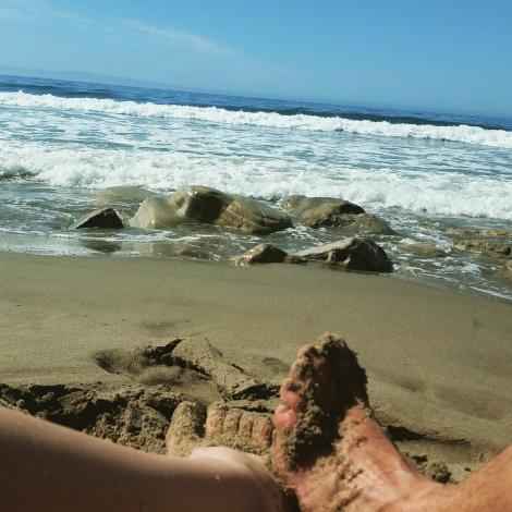 Relaxing on a Santa Barbara Beach after a morning run.