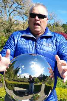 Dad posing by a metal ball