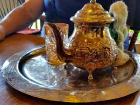 A turkish tea kettle and cup