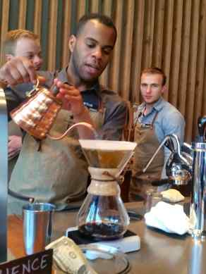 A barista shows us one method of coffee brewing