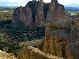A man walks the high rope about 1000ft off the ground
