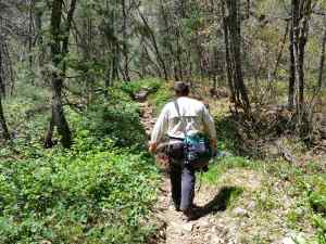 KC hiking in Maple Canyon carrying the rope and his helmet