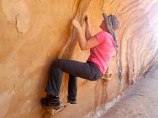 I'm traversing across a wall behind the Navajo Arch