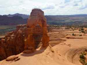 The Delicate Arch with the canyons in the background