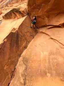 A picture of me as I navigate climbing past the roof. Bad Moki Roof, 5.9 Trad Route
