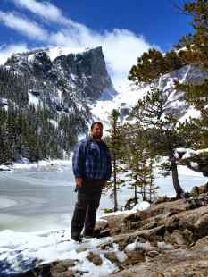 KC at the Emerald Lake with Hallett Peak behind him