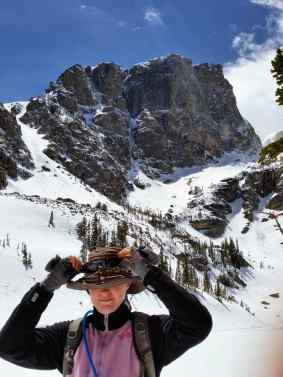 Fixing my hat in front of the Hallett Peak