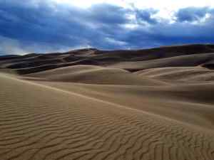 A picture of the dunes with foreboding clouds