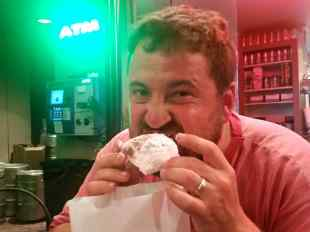 KC trying a beignet