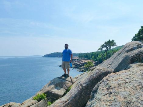 KC and the sea cliffs/rocks of Acadia National Park
