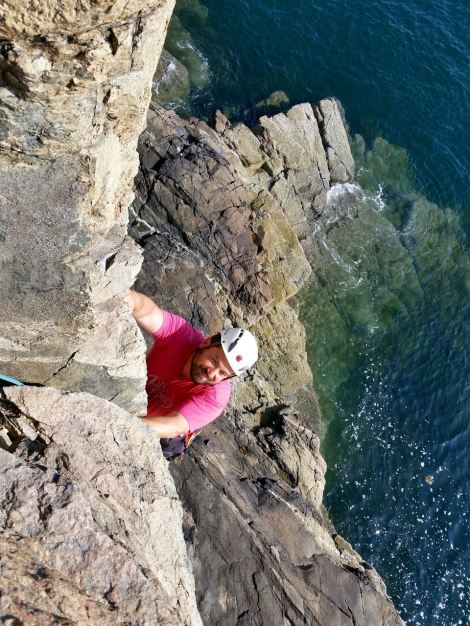 Rock climbing on the Otter Cliffs, Acadia National Park