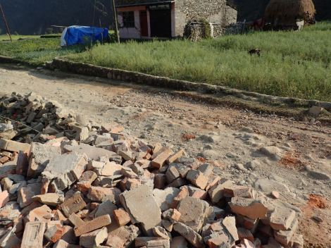 Filling a pothole and making a pile of bricks